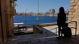 A girl and a boy at Valletta street with a view on Gzira town at Grand Harbor, M Image