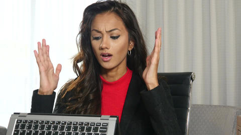 Frustrated Indian businesswoman working on laptop hybrid computer Footage