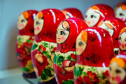 Many red babushkas arranged in a row Photo