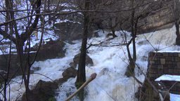White waters of a torrential waterfall in the winter stock video footage Footage