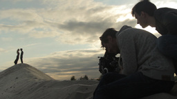 The Cameraman And Director Filming A Romantic Scene With Couple In Love stock footage