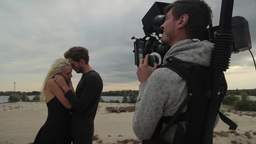The cameraman shoots a scene with hugging a guy and a girl Footage