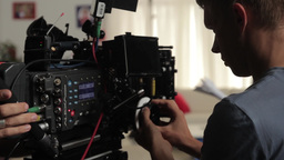 Focuspuller Controls The Focus Of The Camera During Shooting stock footage