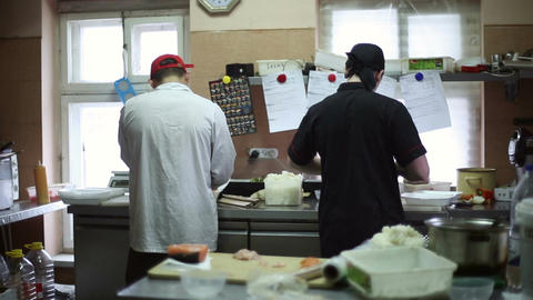Two chefs cook in the kitchen Footage