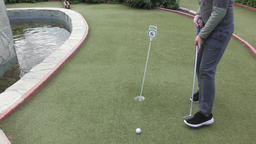 Boy playing in minigolf Footage