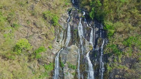 Drone Shows Amazing High Waterfall from Steep Cliffs in Jungle Footage