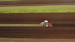 Tractor cultivates the land in the field Footage