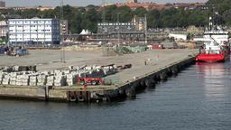 Denmark Scandinavia coastal city of Aarhus docks seen from water side Footage
