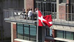 Denmark Scandinavia coastal city of Aarhus national flag and people 画像
