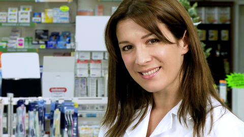 Beautiful young pharmacist working and smiling Stock Video Footage
