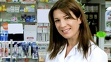 Beautiful young pharmacist working and smiling Footage