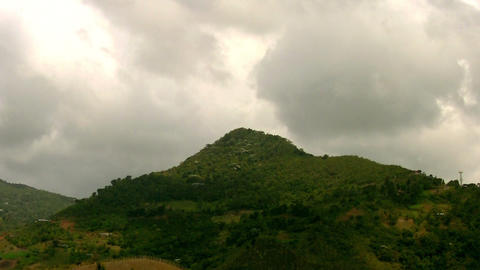 Clouds over mountain 03 Stock Video Footage