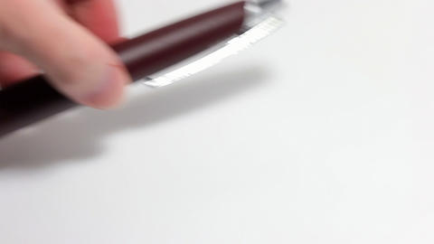 Hand puts the pen Stock Video Footage