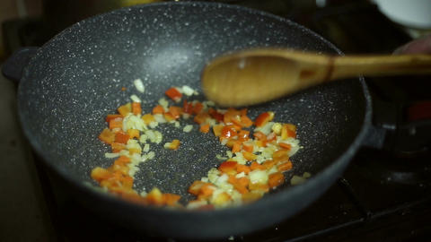 Vegetables are fried in the frying pan Footage