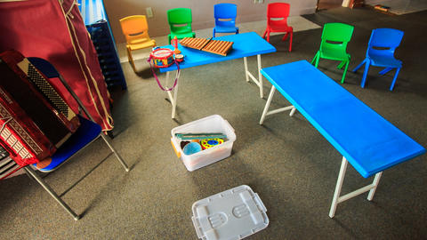 Small Tables Chairs In Kindergarten Toy Boxes Motion stock footage