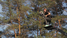 Cameraman with a camera on the crane at high altitude.(film production) outdoors Footage