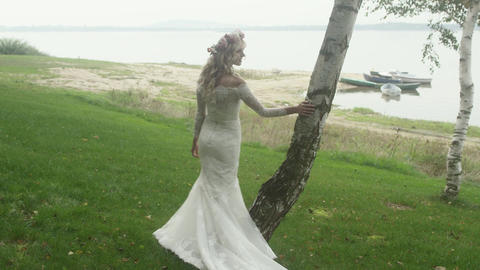 Pretty bride enjoying summer summer weather close to the nature Footage
