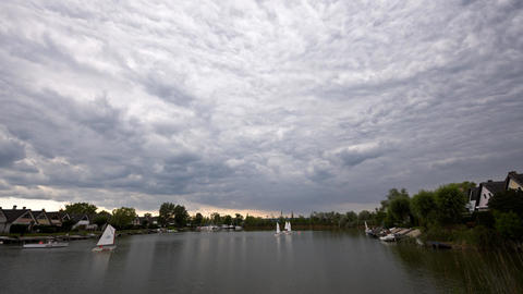 Summer lake activities under dull sky Image