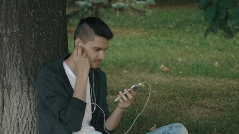 Young handsome man listening to music on headphones Footage