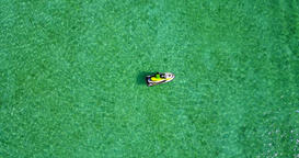 v06152 Aerial flying drone view of Maldives white sandy beach jetski riding sunn Footage