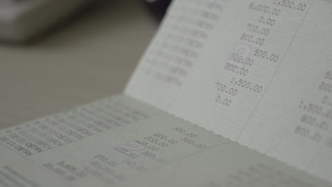 Hands of man work with bank book saving account and small house passbook concept Filmmaterial
