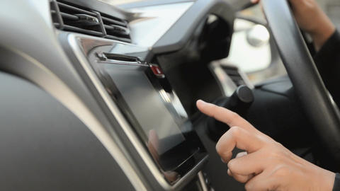 Close up shot hand of woman using touch screen in car shallow depth of field 002 Footage