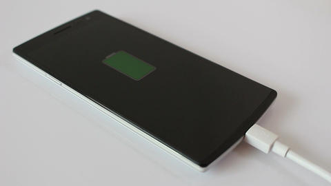 Smartphone is charging battery cell Live Action