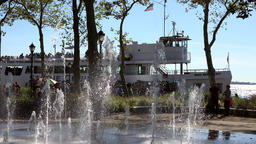 USA New York City southern Manhattan pier fountains in front of ferryboat Footage