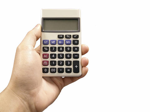 Male hand with calculator フォト