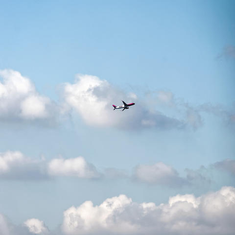 Wizz air airplane flying high in sky with white clouds Photo