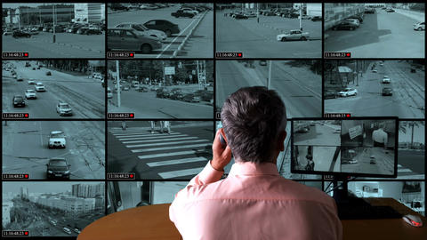 Man controls the system of monitoring the streets of the city Filmmaterial