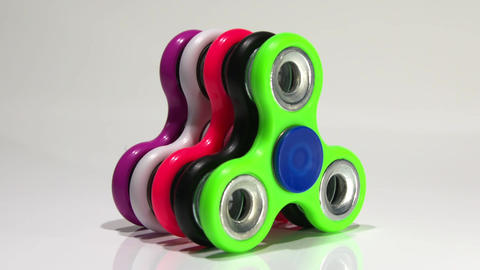 Several multi-colored spinners on the table Footage