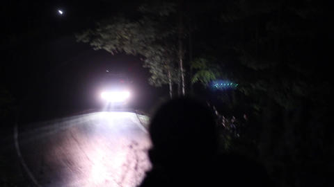 Car rally going with speed on a winding mountain road during a competition held  Live Action