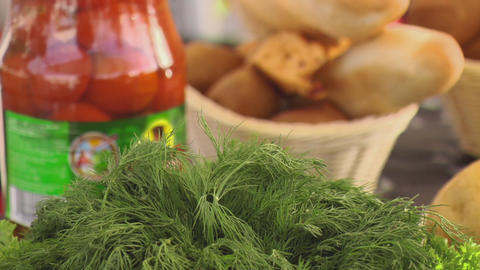 Green parsley focus in, baguette in basket, bank with tomato focus in on a table Live Action