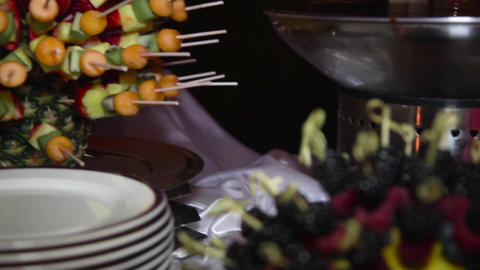 Mix of fruits and berries on wooden sticks Footage