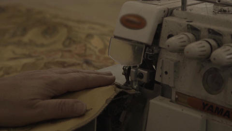 Sewing machine makes seams on sheathing in furniture factory Footage