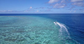 v06231 Aerial flying drone view of Maldives white sandy beach jetski riding sunn Footage