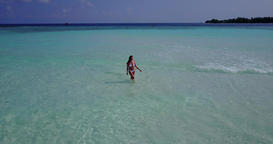 v06251 Aerial flying drone view of Maldives white sandy beach 1 person young bea Live Action