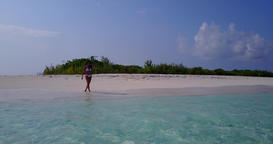v06289 Aerial flying drone view of Maldives white sandy beach 1 person young bea Live Action
