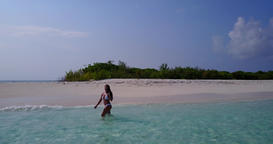 v06290 Aerial flying drone view of Maldives white sandy beach 1 person young bea Live Action