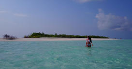 v06308 Aerial flying drone view of Maldives white sandy beach 1 person young bea Live Action