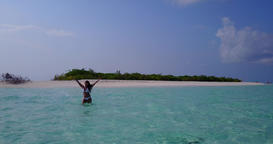 v06307 Aerial flying drone view of Maldives white sandy beach 1 person young bea Live Action