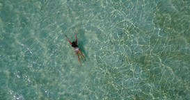 v06311 Aerial flying drone view of Maldives white sandy beach 1 person young bea Live Action