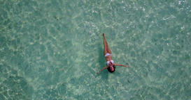 v06325 Aerial flying drone view of Maldives white sandy beach 1 person young bea Live Action