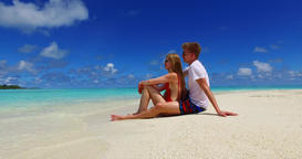 v07419 Maldives white sandy beach 2 people a young couple man woman sitting toge Footage
