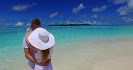 v07472 Maldives white sandy beach 2 people a young couple man woman standing tog Footage