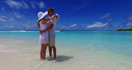 v07483 Maldives white sandy beach 2 people a young couple man woman standing tog Footage