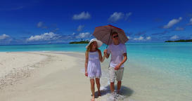 v07505 Maldives white sandy beach 2 people a young couple man woman walking toge Footage