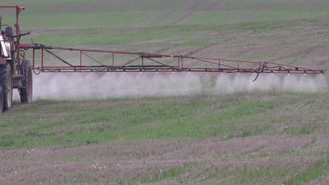 sprayer wing spray special liquid to kill weeds in stubble field. 4K Live Action