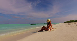 v07841 Maldives white sandy beach 1 person young beautiful lady sunbathing alone Live Action